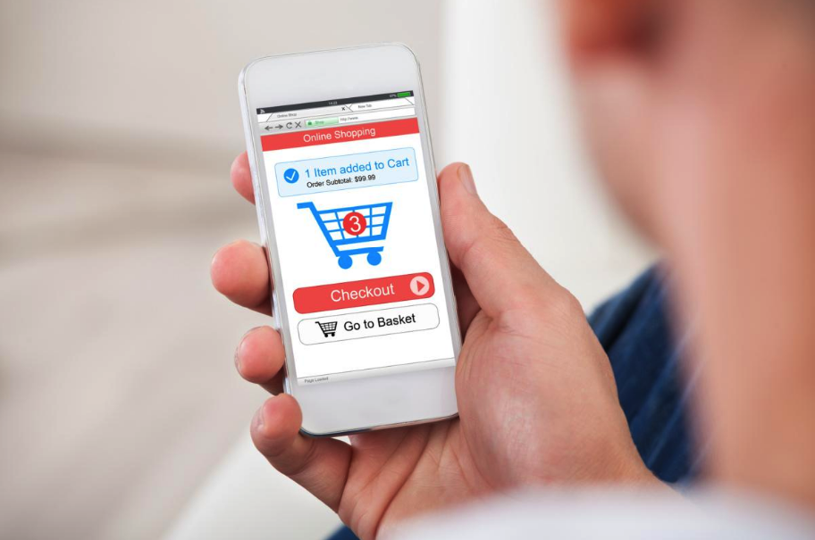 Man holding mobile phone shopping online and checking out